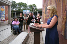 Poet reading at Erie Canal Museum event.