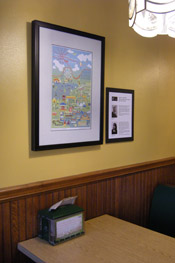Framed poster print and text board at Nikos Deli