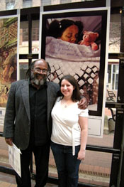 Arthur Flowers, poet, and Erin Schechtman, artist, with Syracuse poster